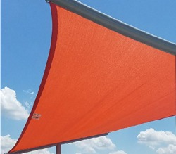 Rectangular shade structure fabric in front of sky.