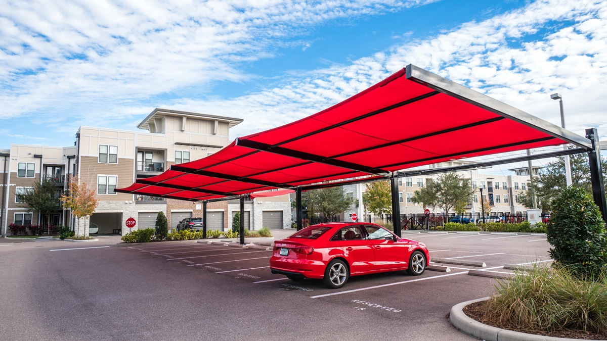 Square shade structure over parking lot row.